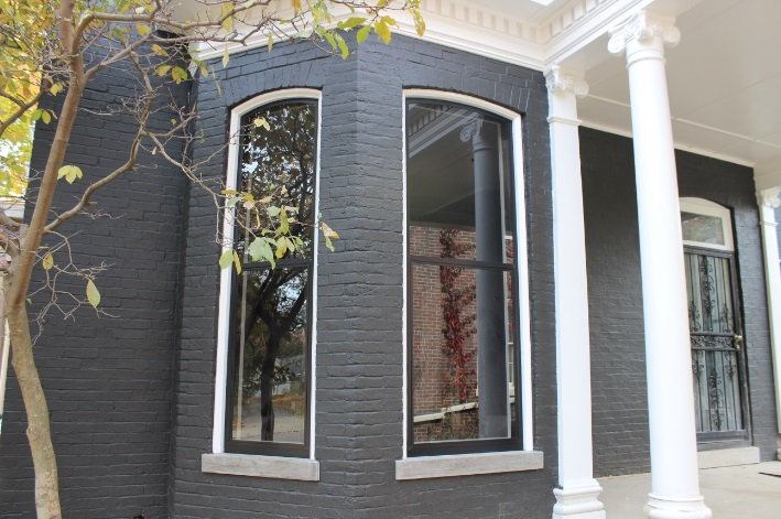 Historic Storm Window in Black on Victorian Home