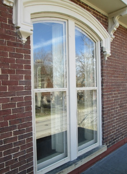 historic window restoration and storm window installation